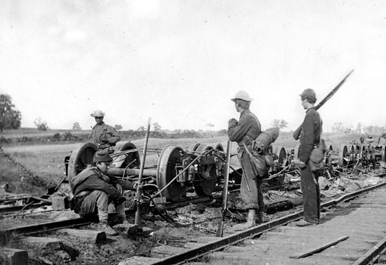 1862 August Manassas Junction, Va. Soldiers beside damaged rolling stock of the Orange & Alexandria Railroad