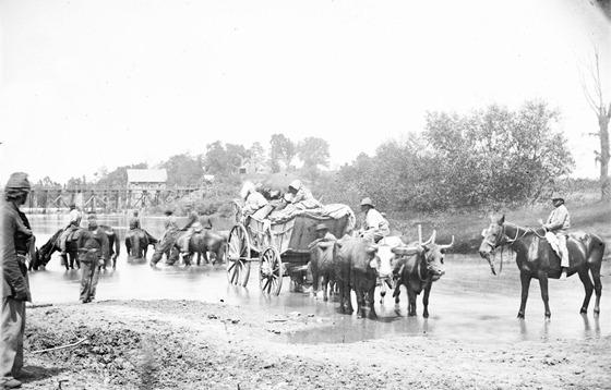 1862 August Rappahannock River, Va. Fugitive African Americans fording the Rappahannock