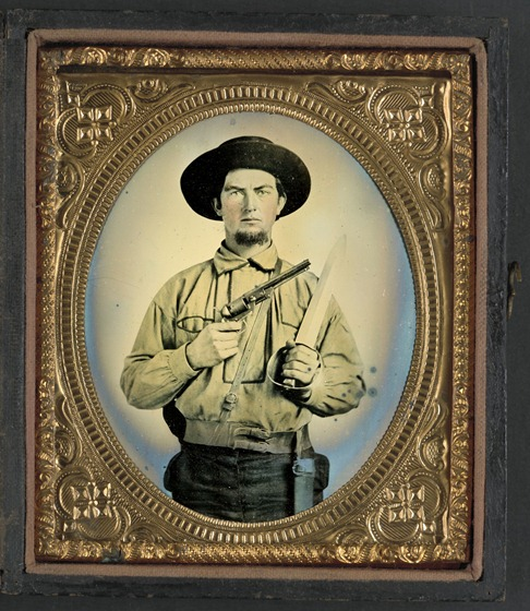 Unidentified soldier in Confederate uniform with Colt Navy revolver and double handle D-guard Bowie knife