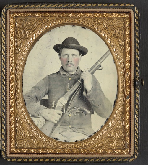Unidentified soldier in Confederate uniform with Berdan's Sharps rifle and Colt 1862 Police Model pistol