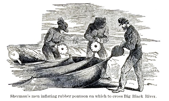 Sherman's men inflating rubber pontoon on which to cross Big Black River
