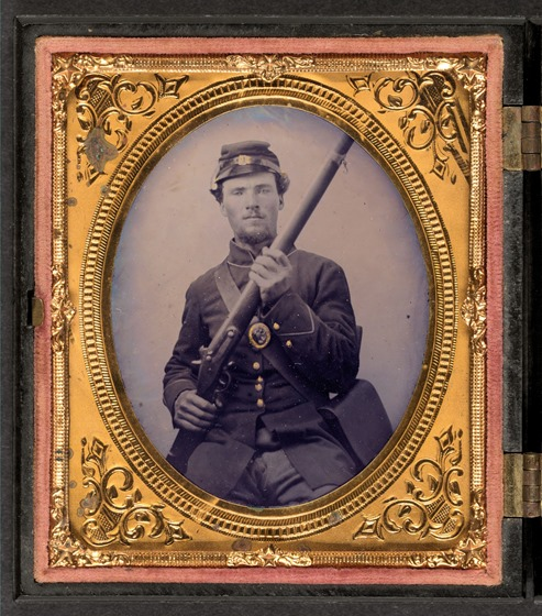 Private Jacob Harker of Company C, 120th Ohio Volunteers in uniform with musket and haversack