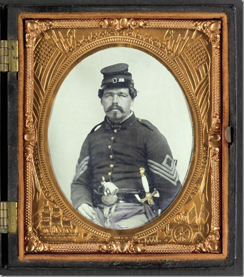 Unidentified soldier in Union first sergeant's uniform with militia sword and revolver