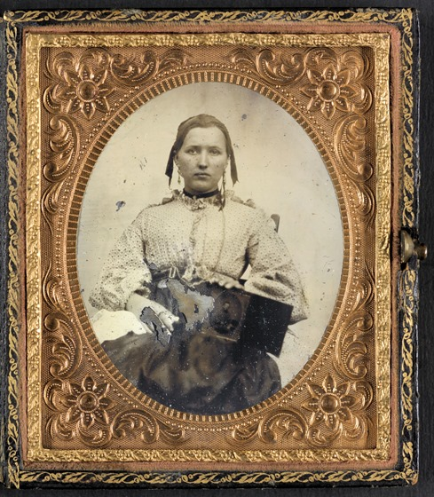 Unidentified woman with cased photograph of Private W.R. Clack Co. B, 43rd Tennessee Infantry Regiment