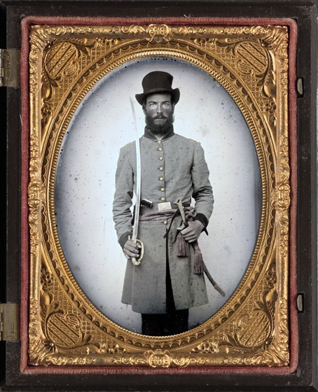 Captain Augustus C. Thompson of Co. G, 16th Georgia Infantry Regiment with sword in photo case