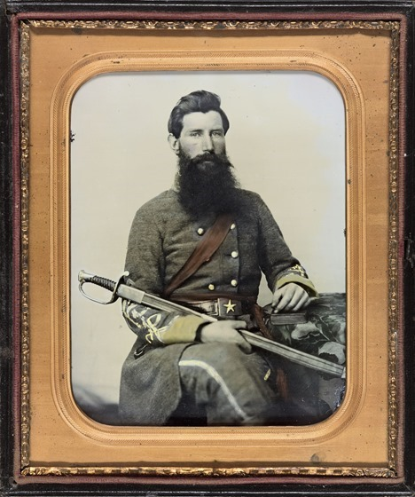 Captain George W. Hackworth of Co. F, 1st Virginia Cavalry Regiment, in uniform with sword in photo case
