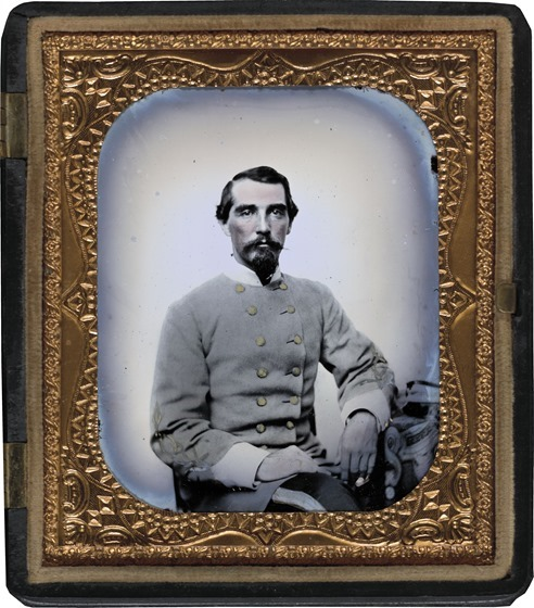 Unidentified soldier in Confederate double-breasted frock coat with single row of braid denoting the rank of lieutenant in photo case
