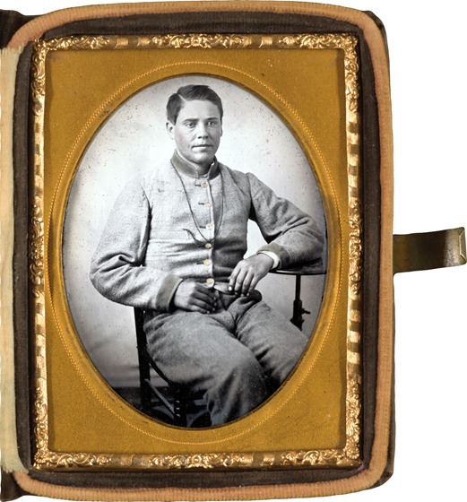 Unidentified soldier in Confederate uniform with lanyard around his neck in photo case