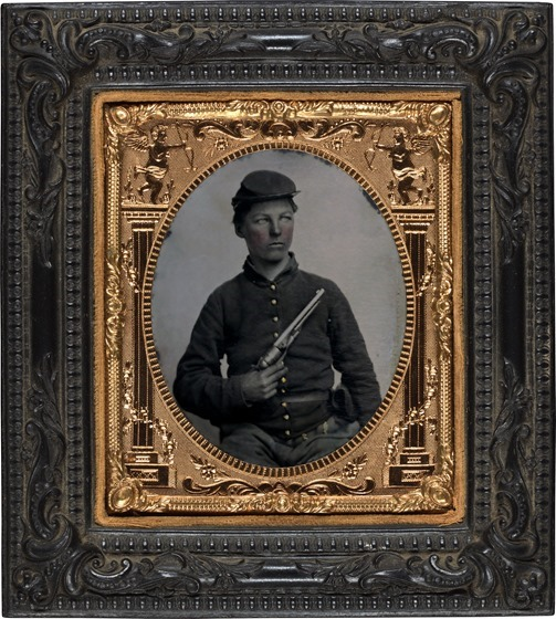 Unidentified soldier in Union uniform with Colt Army Model 1860 revolver in photo case