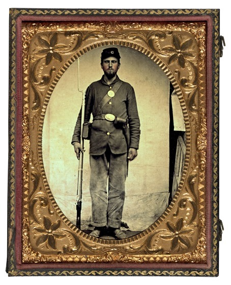 Unidentified soldier in Union uniform with bayoneted musket, cartridge box, and cap box2 in photo case