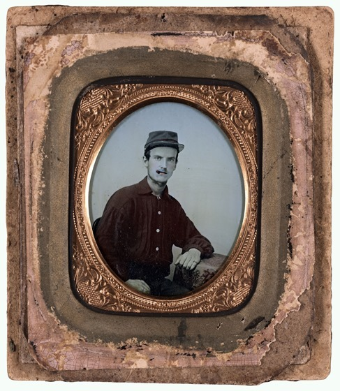 Unidentified soldier in red battleshirt and kepi in picture frame