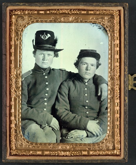 Brothers Private Hiram J. and Private William H. Gripman of Company I, 3rd Minnesota Infantry Regiment, one with his arm around the other -- in frame