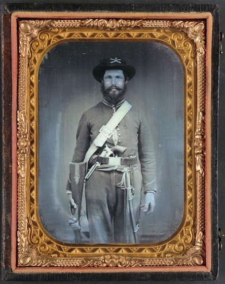 Unidentified cavalry soldier in Union uniform with Sharps carbine rifle, Colt revolver, and cavalry saber -- in case