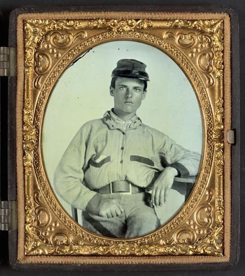 Unidentified soldier in Confederate battleshirt, kepi, and wishbone belt buckle -- in frame