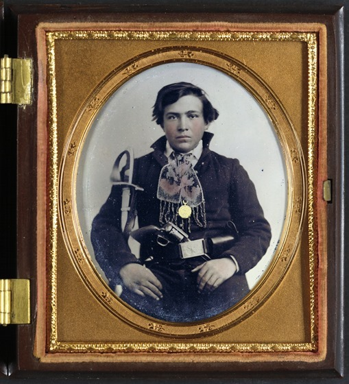 Unidentified soldier in Confederate uniform with cavalry sword and revolver -- in frame