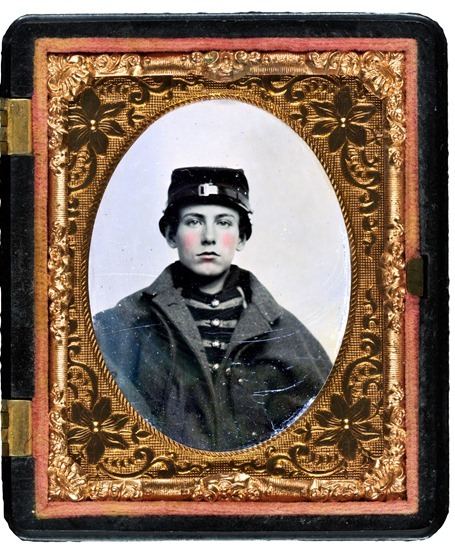 Unidentified young soldier in Union musician's uniform and coat in case
