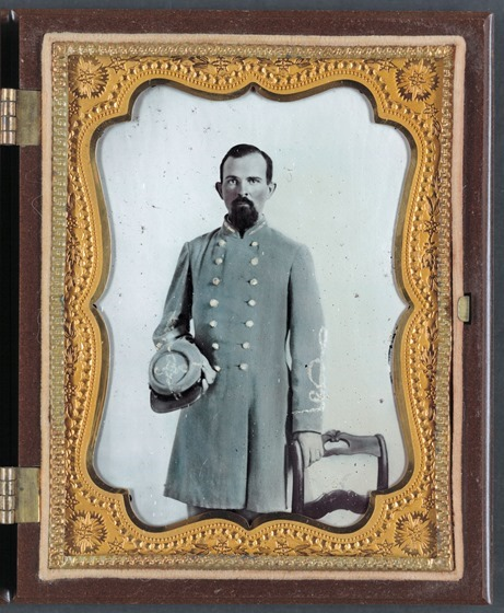 Unidentified officer in Confederate lieutenant's uniform with kepi - in frame