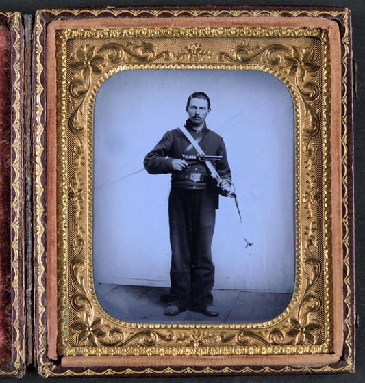 Unidentified soldier in Union cavalry uniform with Colt -- in frame
