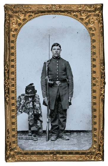 Unidentified soldier in Union frock coat with bayoneted musket-- in frame