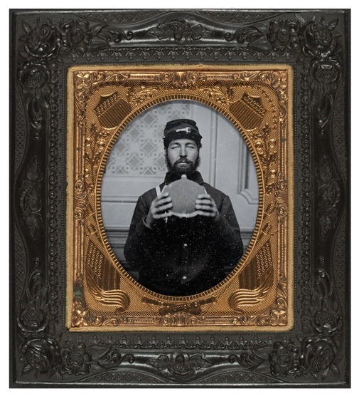 Unidentified soldier in Union uniform with canteen -- in frame