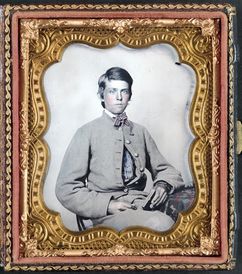 Unidentified young soldier in Confederate private's uniform -- in frame